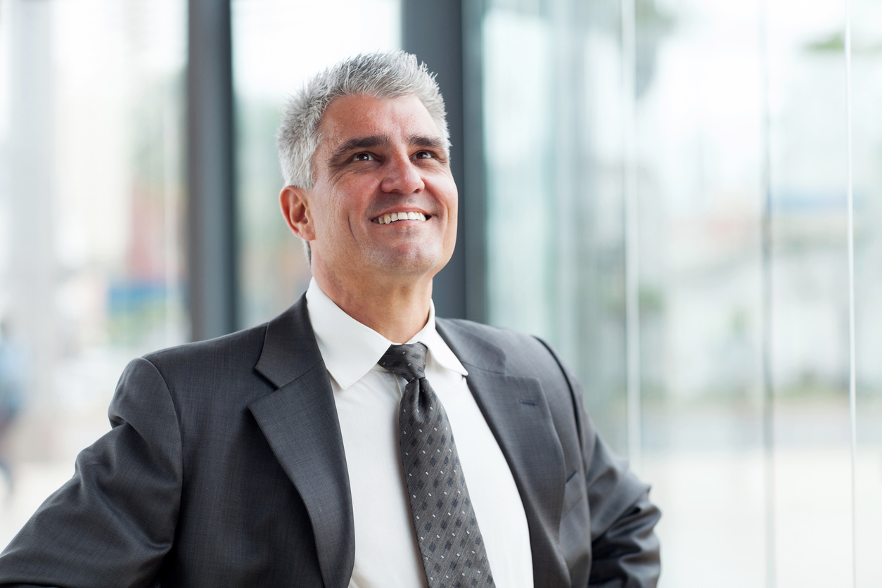 middle-aged businessman looking up